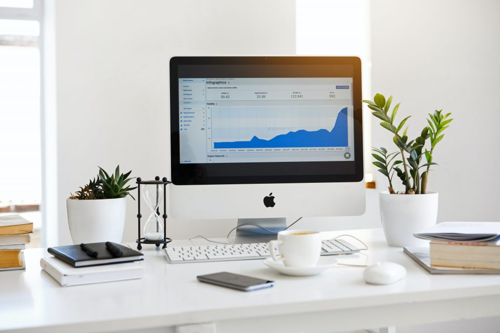 Apple iMac & Accessories on white desk with plants Digital Marketing