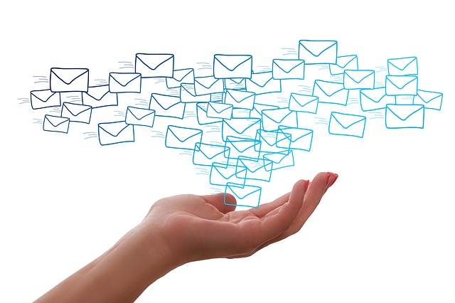 A hand holding letters - to indicate email marketing